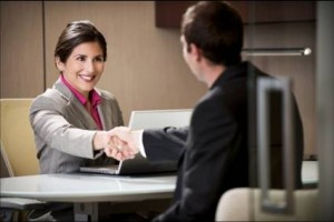 man and woman shaking hands sitting down